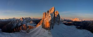 Tre Cime in Dolomites mountains at sunrise by jaroslavnisler