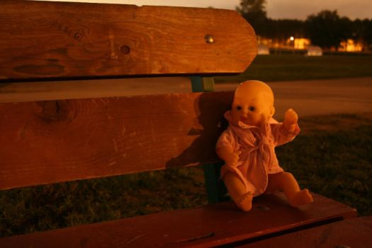 Doll on a parkbench by elverloho