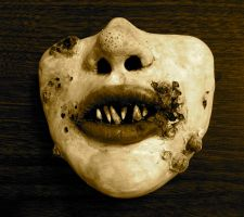 Sculpey face, sepia tone by pink-porcupine