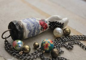 Antique Porcelain Tattooed Doll Arm Necklace #1 by asunder