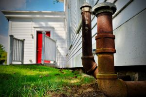 Rusted Pipes and Red Door by PAlisauskas