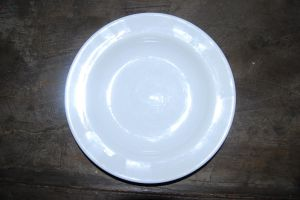White Dish Black Table by Markhal