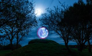 Blue ball of light on a hill by chivt800