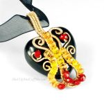 Red, Yellow, Black and Gold Heart Necklace by sylva