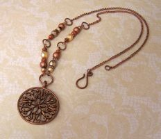 Copper medallion necklace by asukouenn