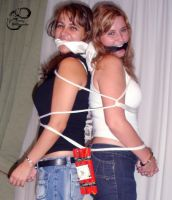 2 girls handcuffs and tied by fotologalgemadas