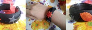 Warm flower decal bangle by dobharachu