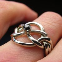 Black diamond puzzle ring by nellyvansee