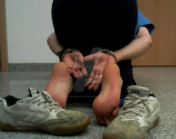 Boy kneeing, skater sneaks, hands and feet tied up by SneakerBoyBondage