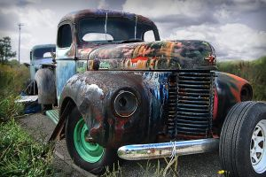Rusted Trucks at the end of the Road by chilihook