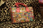 sticker bombed purse by KitterLaGore