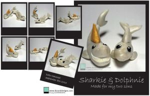 Dolphnie and sharkie by lizzarddesigns