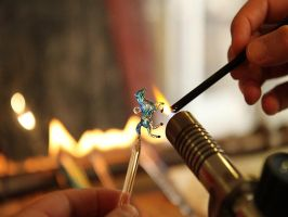 While flameworking a glass horse pendant.. by Glasmagie