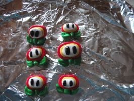 Super mario fireflower badges and fridge magnets by chaobreeder16