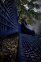 on a park bench by Janikaa