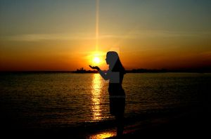 Woman holds the sun by CoffeeDoctor