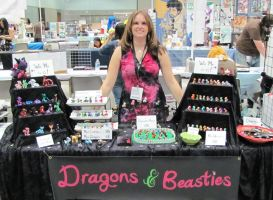 Artist Alley Table 2011 by DragonsAndBeasties