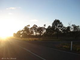 Sunrise on the Road Home by CuriouserX10