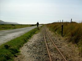 Narrow gauge tracks and distant Man by klambert94