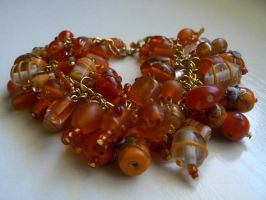 Orange beaded bracelet by luthienblack