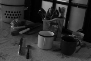 cluttered table by ElegantAndrogyne