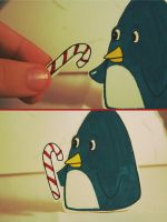 .candy cane for the penguin. by YukiKurenai