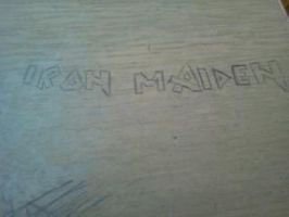 Iron Maiden Logo on table by edge4923
