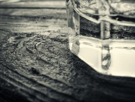 Glass on the wooden table by mb-neo