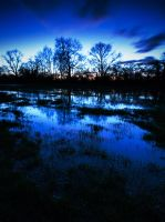 Flood waters in the early evening by davepphotographer