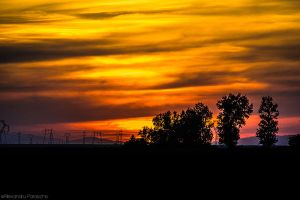 Giant silhouettes admiring the sunset by AlecsPS