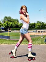 Roller Girl Stops to Pose by paulvdaley