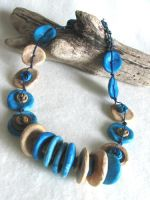 Blue Disk Necklace by desertwind56