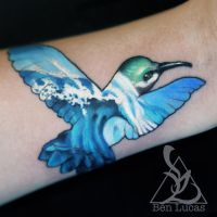 Hummingbird and tidal wave small wrist tattoo by Ben-Lucas