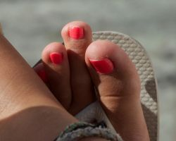 Pink Toes in Flip Flops Close Up 2 by Feetatjoes