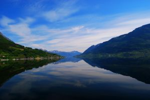 Mirror in the Water at Hardangerfjord in Norway by Thetoril