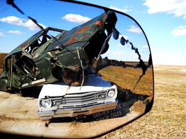 Objects in the rear view mirror... by WayvDesigns
