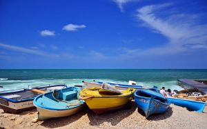 Boats by the beach by bee-eye
