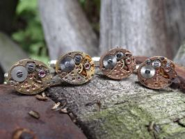 Steampunk colored cufflinks by Hiddendemon-666