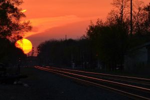 Sunset over the NS Chicago Line 4-2-12 by the-railblazer