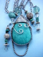Turquoise pendants by LittleLyra