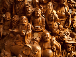 Carved Wooden Characters and Coins by vanfoto