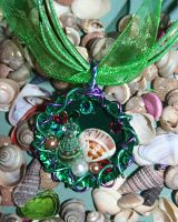 Green seashell bottle cap necklace by SuperFlashDance