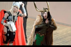 Lady Loki and fem Thor on stage by Asterateya