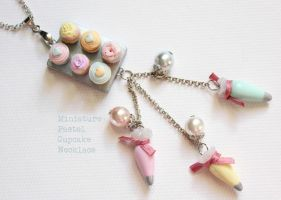 Handmade Pastel Cupcake Necklace with icing sugar by LaNostalgie05