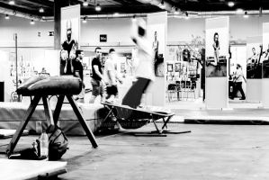 Young man jumping a pommel horse by lawmoment