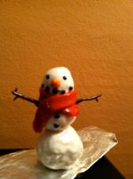 Snowman gift by MaskedRascal