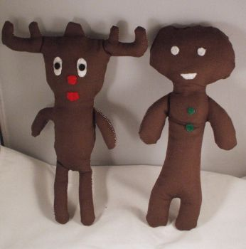rudolph and gingerbread man by Emmylu91