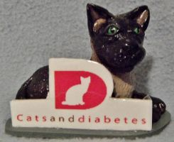 Cat with logo poylmer clay sculpture by CreativeCritters