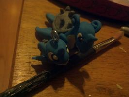 Lapras Figure + Necklace Charm by strangmusicobsession