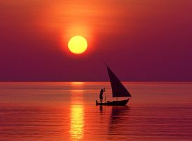 Sunset with small boat by DicklessHunter